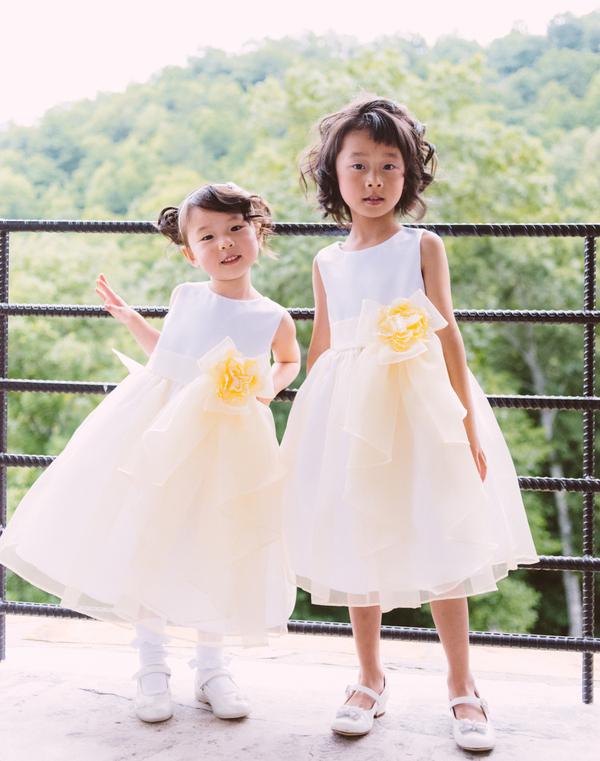 Asian American flower girls with light yellow flower girl dresses
