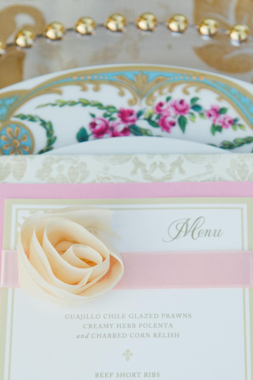 Light pink wedding menu with pastel fabric flower