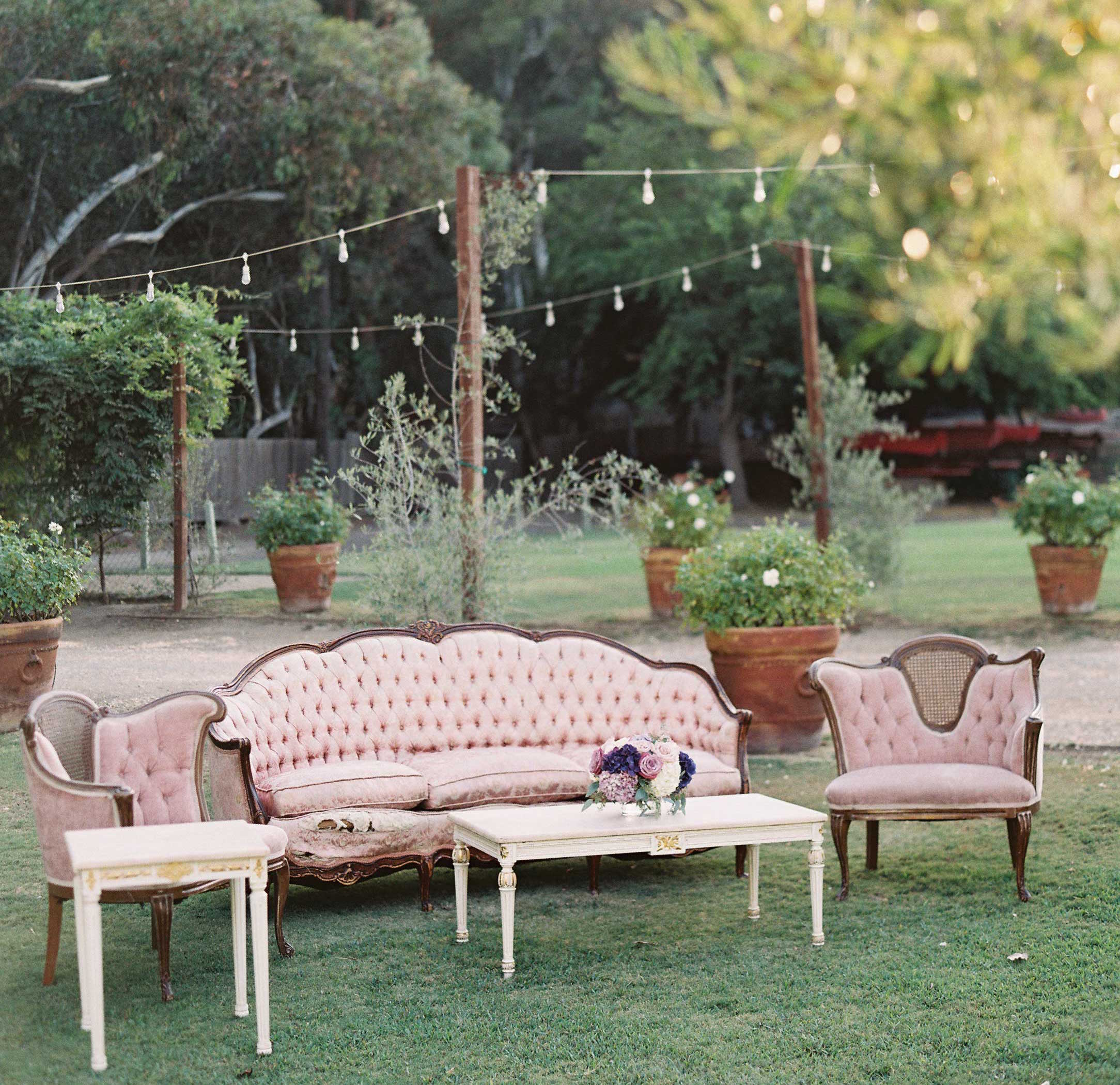 Light pink dusty rose antique lounge area with pastel upholstery