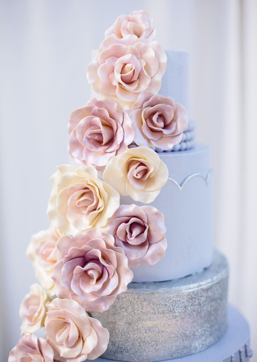 Light purple pastel wedding cake with pink sugar flowers