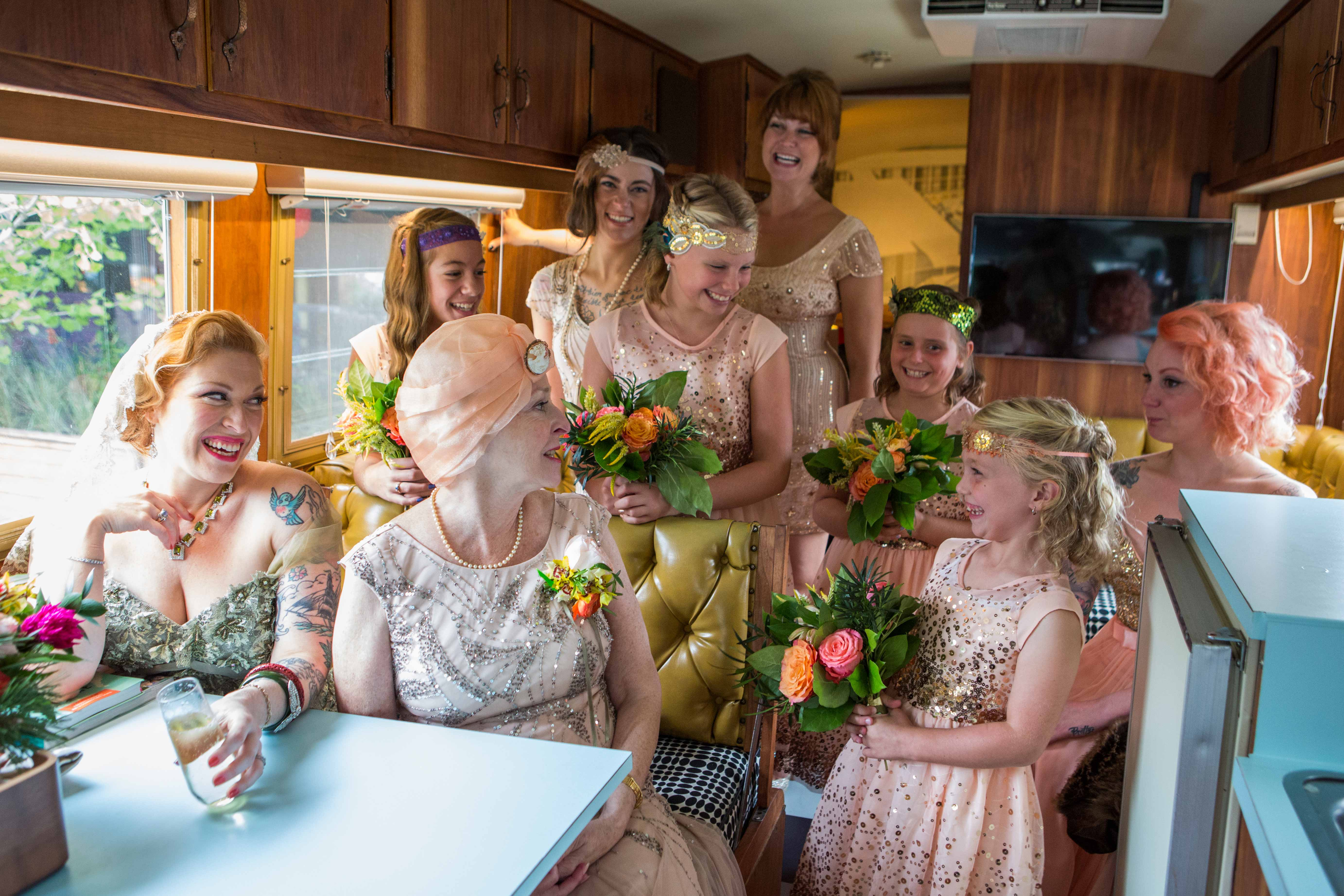 Bride in green wedding dress, mother of bride, family on transportation to wedding