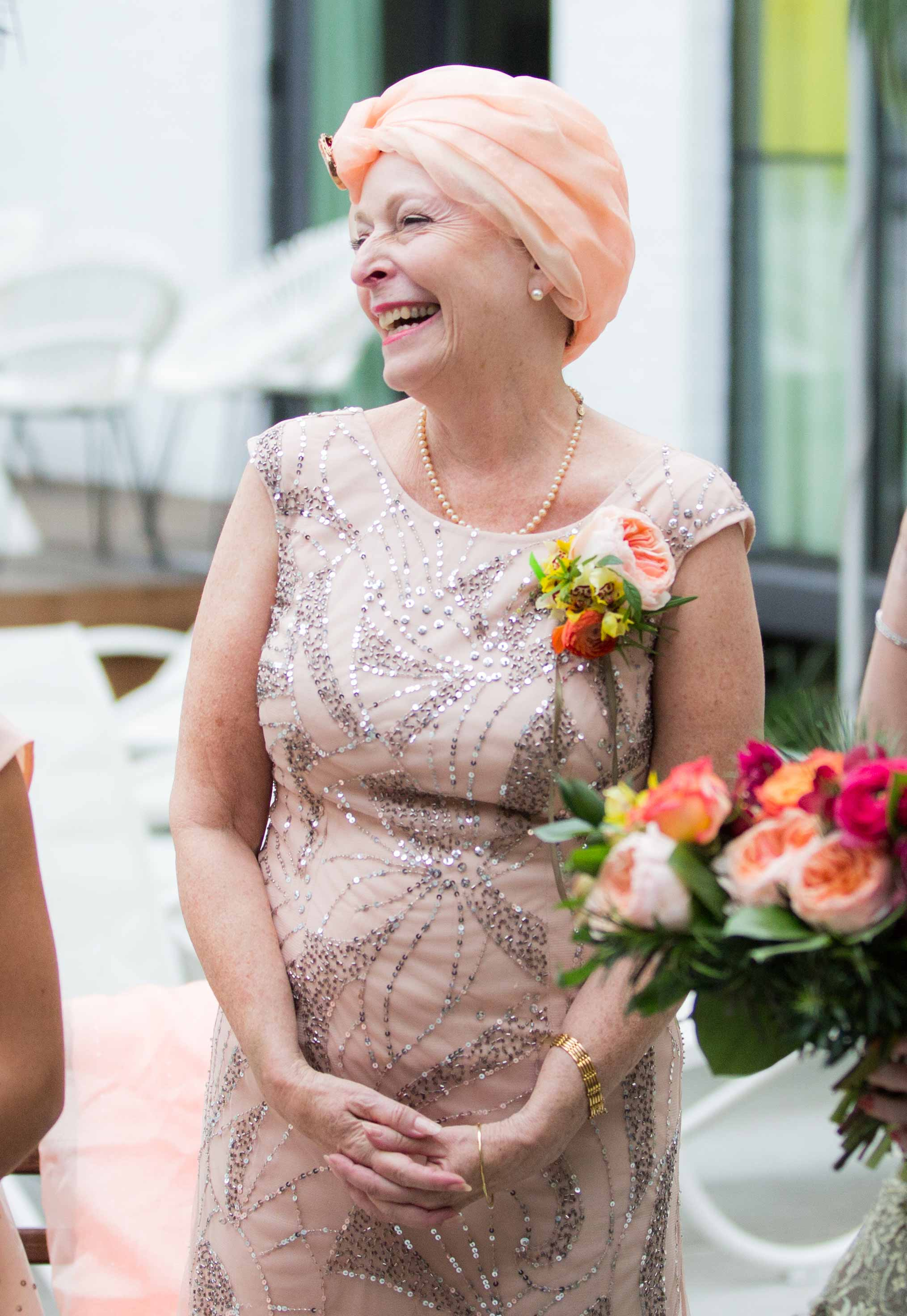 Mother of bride matron of honor in peach dress with sequins stage four ovarian cancer at wedding