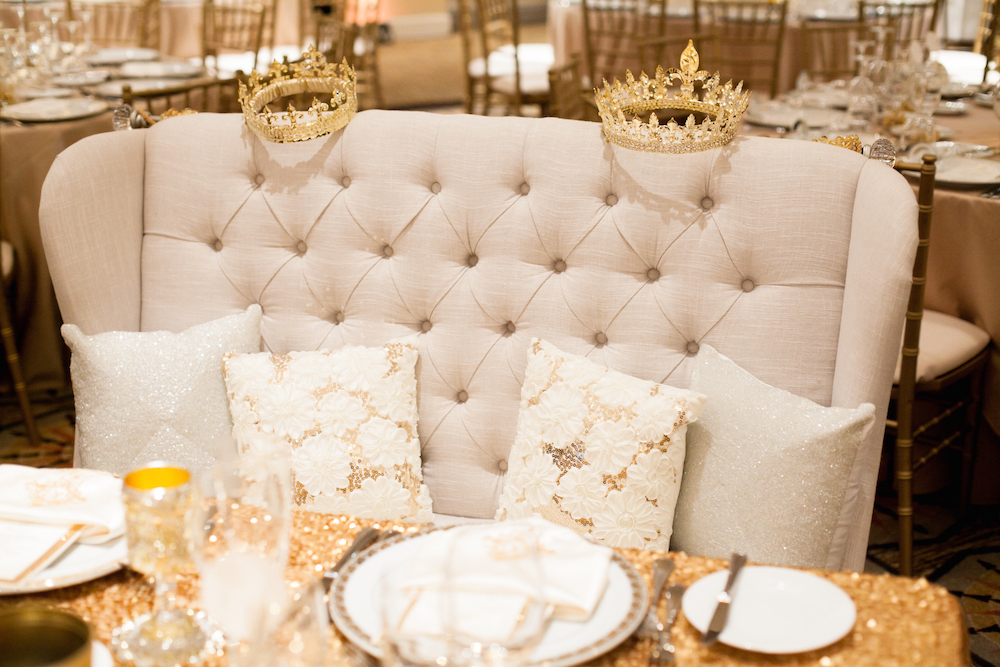 White tufted settee sweetheart table with crowns