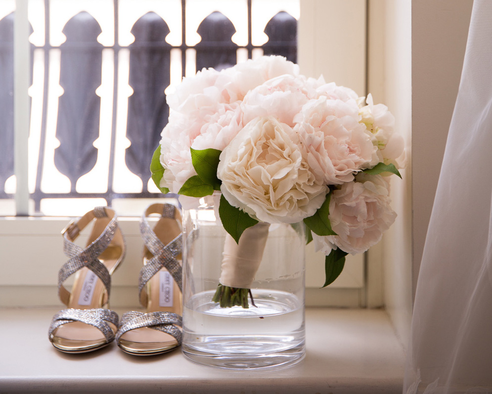 White and light pink peony wedding bouquet in vase