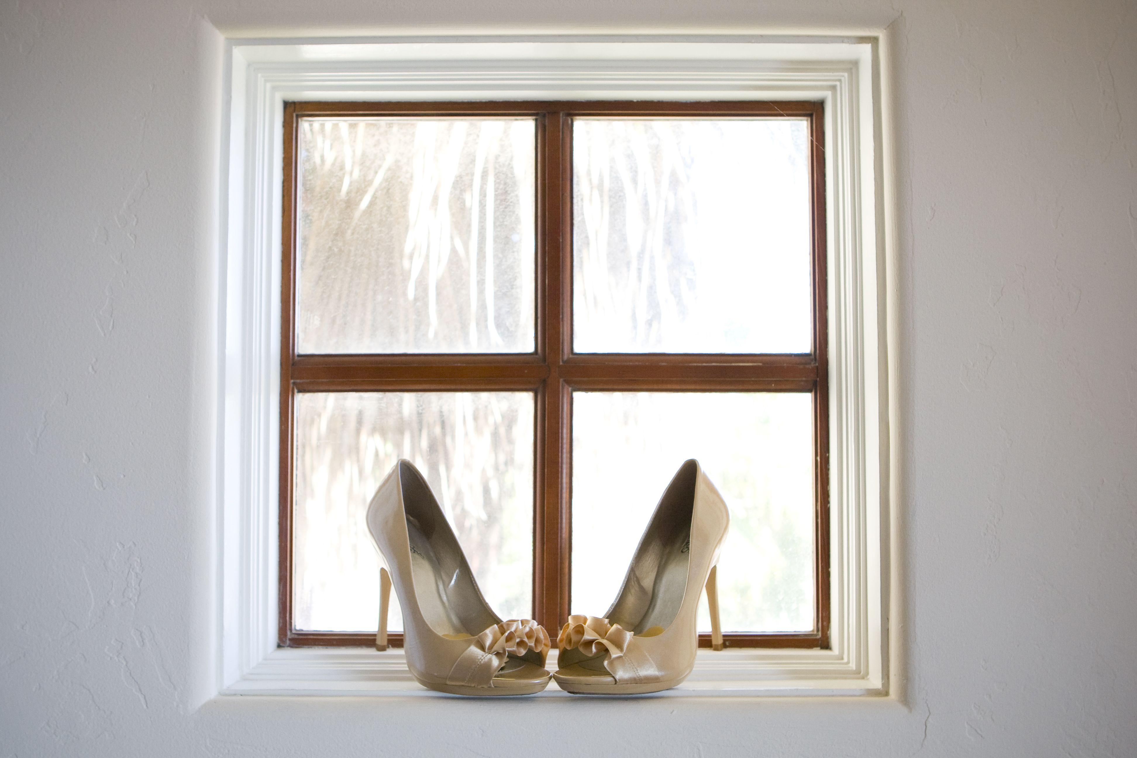 Ruffle wedding shoes at wedding on window sill
