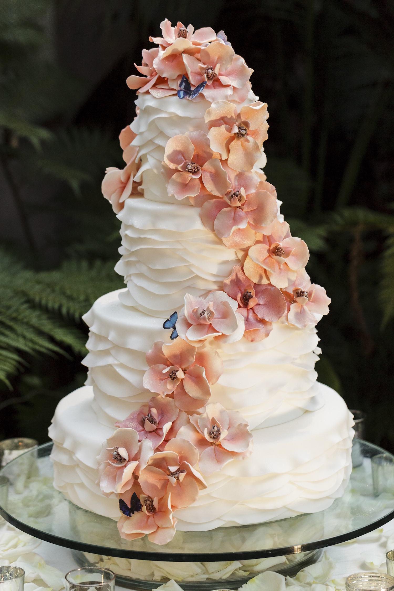 White ruffle wedding cake with cascading sugar flowers
