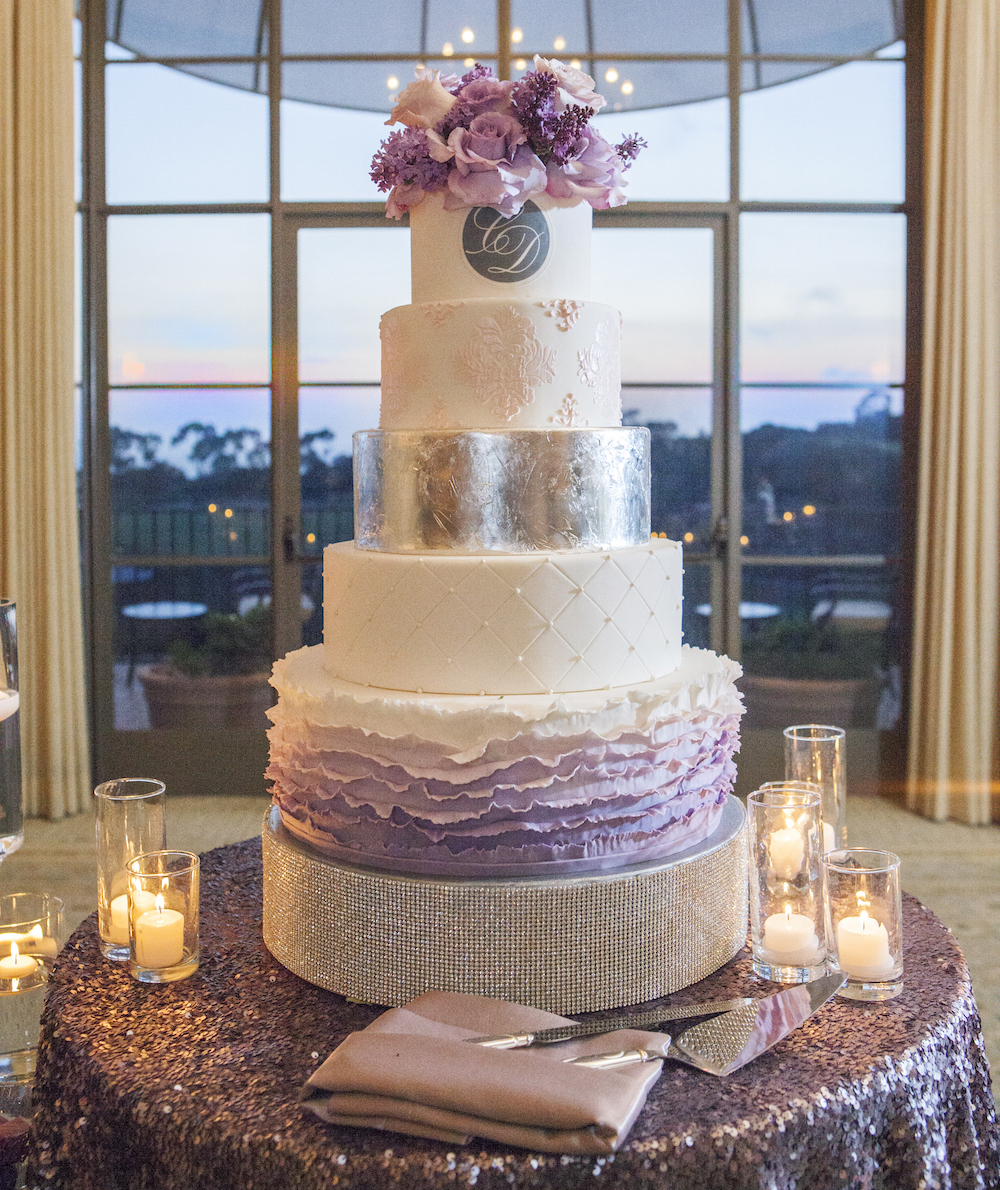 Silver and purple ombre wedding cake with ruffle decorations