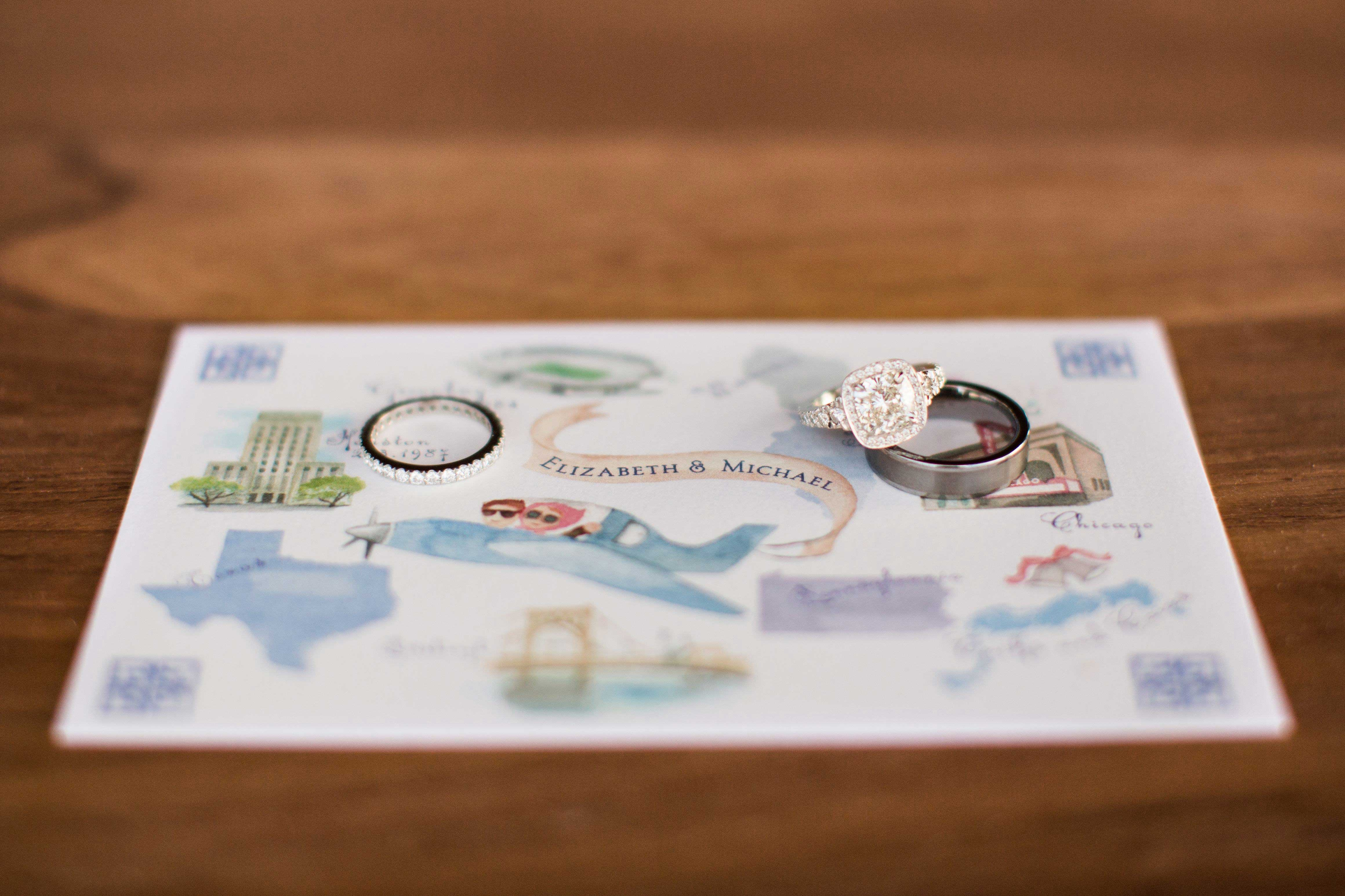 Watercolor map with engagement ring and wedding ring