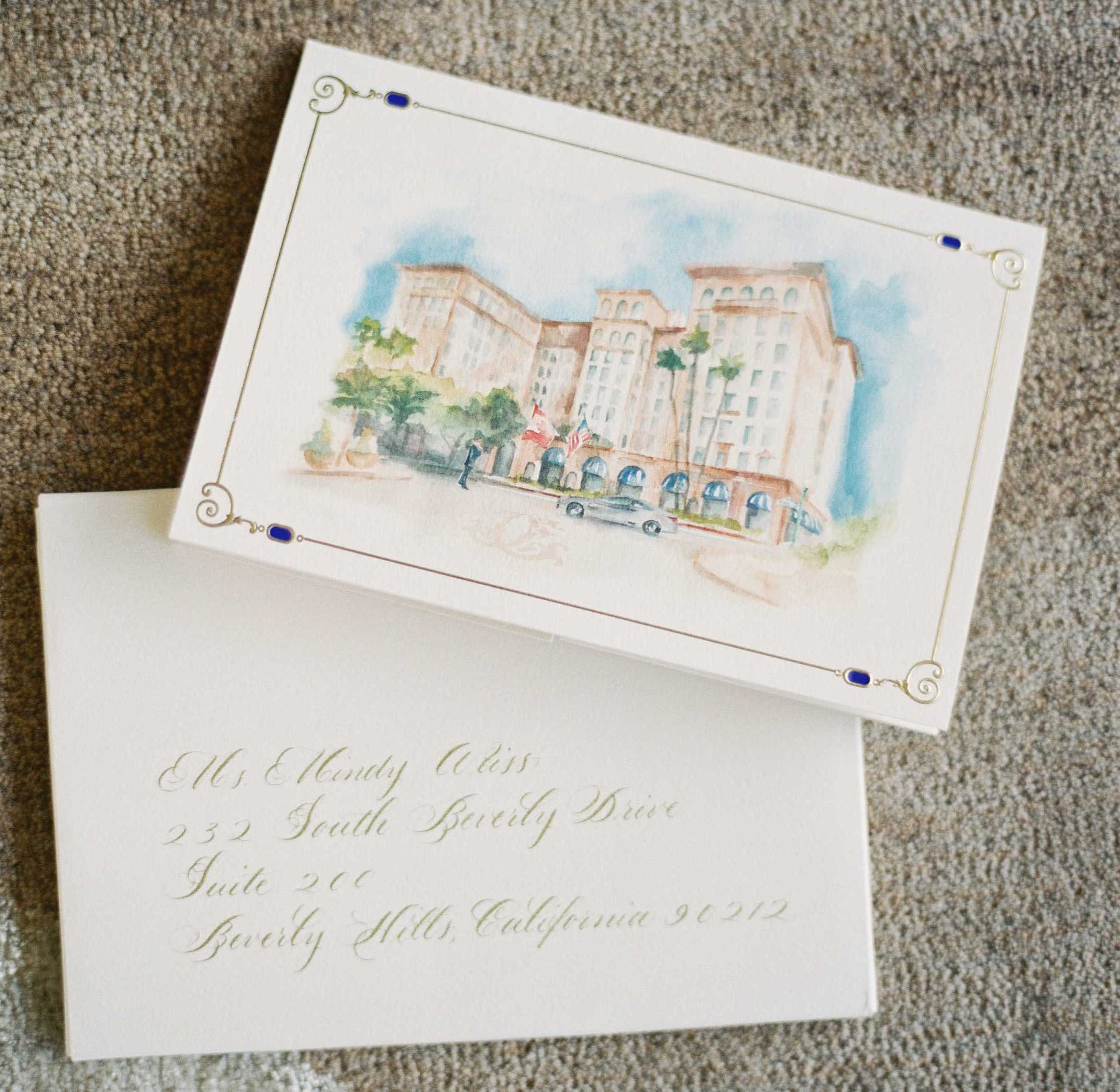 Watercolor painting of venue on wedding invitation