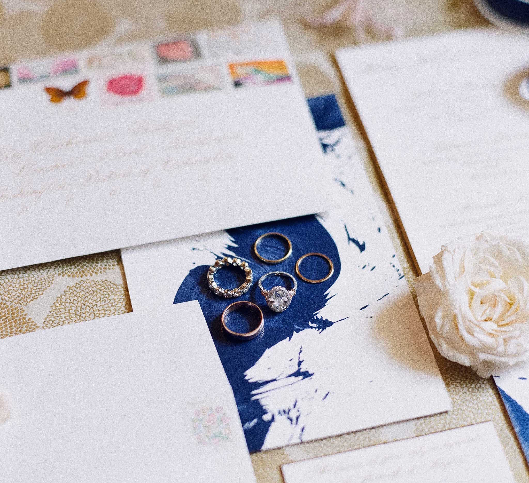 Custom wedding invitation with blue paint brush stroke design