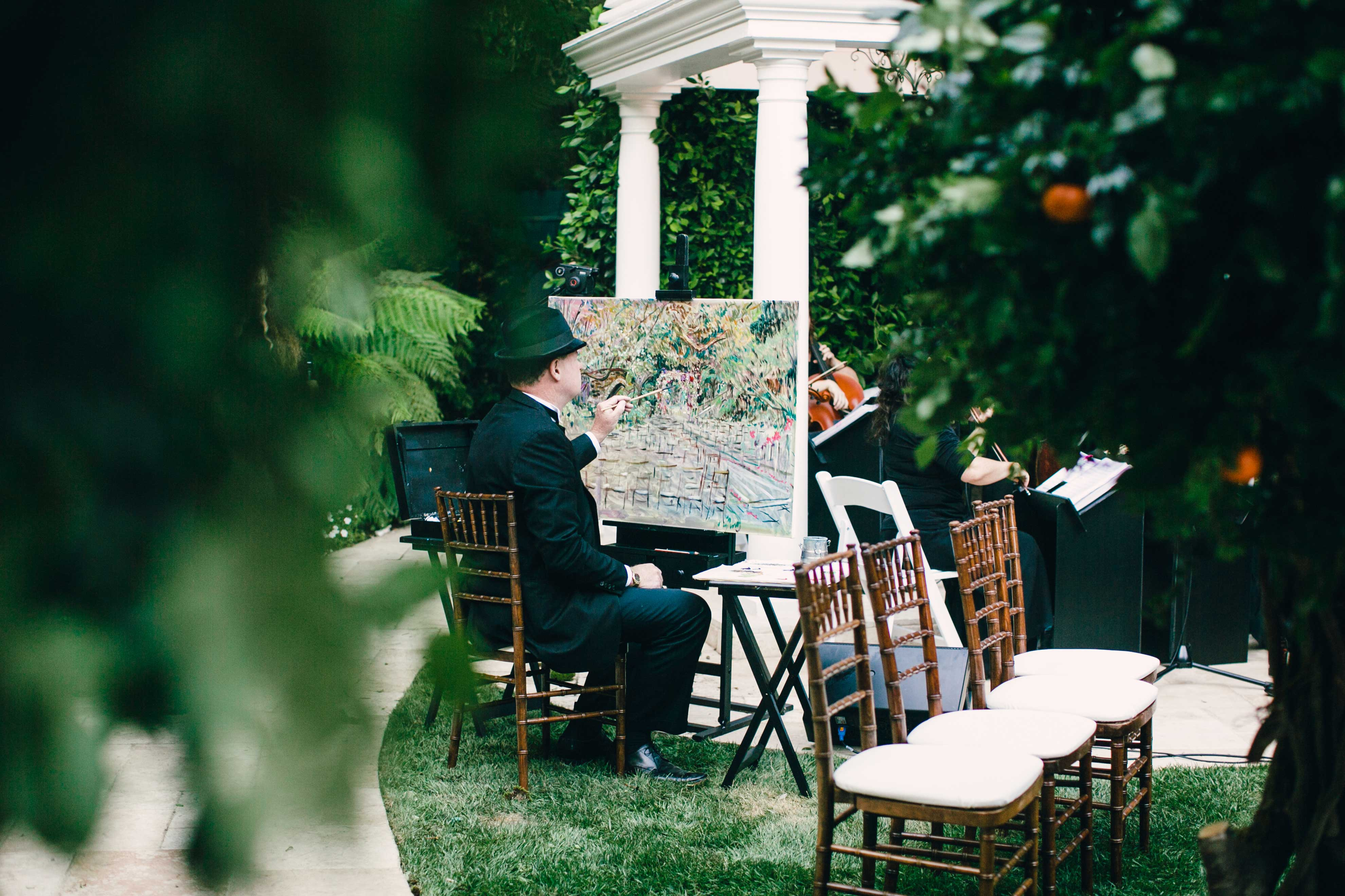 Live painter at outdoor wedding ceremony in Beverly Hills