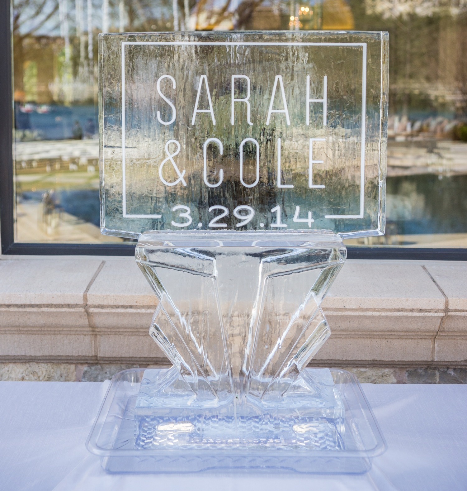 Ice sculpture at wedding with bride groom names and wedding date