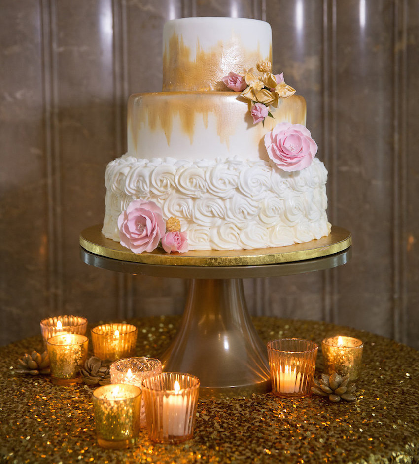 White small wedding cake with gold paintbrush strokes