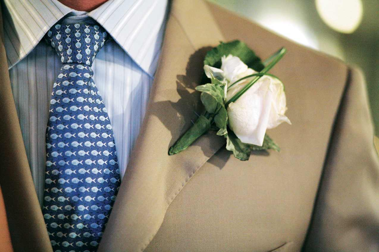 groom with blue tie and blush fish pattern