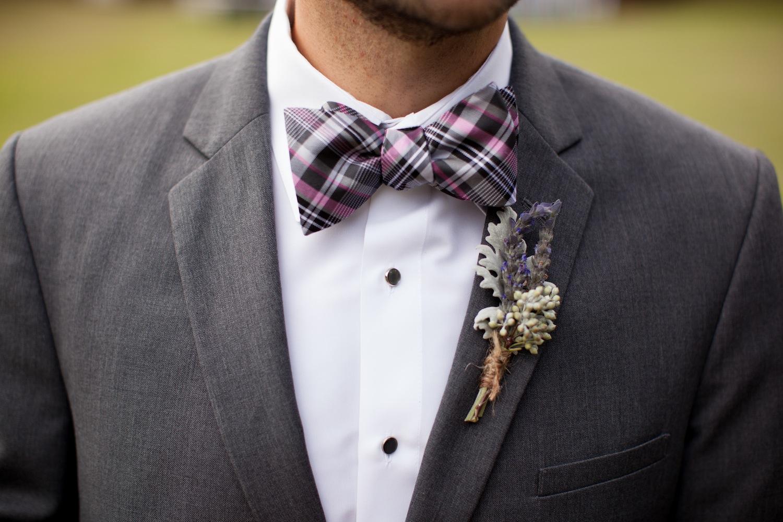 groom pink and black plaid bow tie