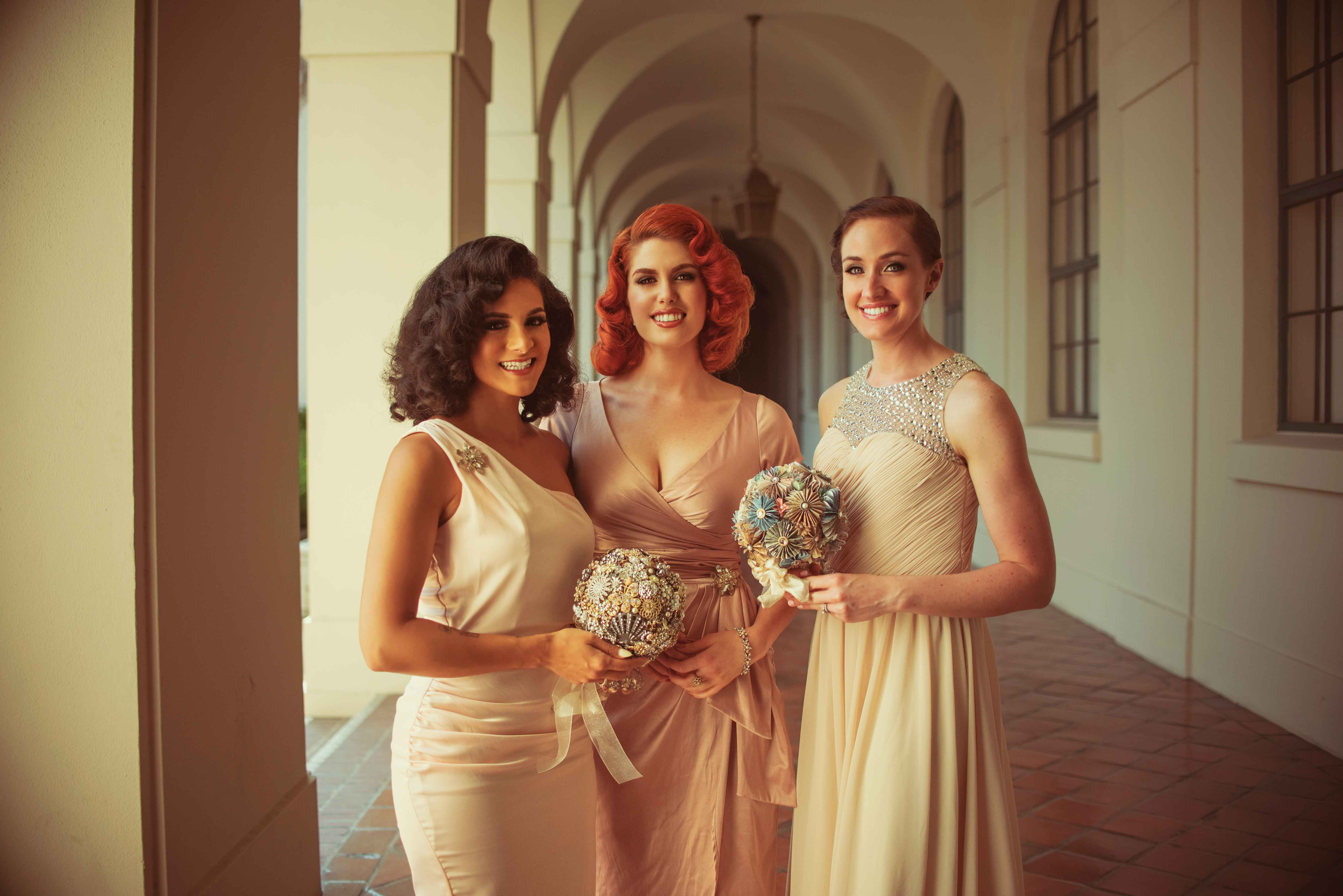 Miss Rockabilly Ruby bridesmaids in mismatched dresses with brooch and paper bouquet
