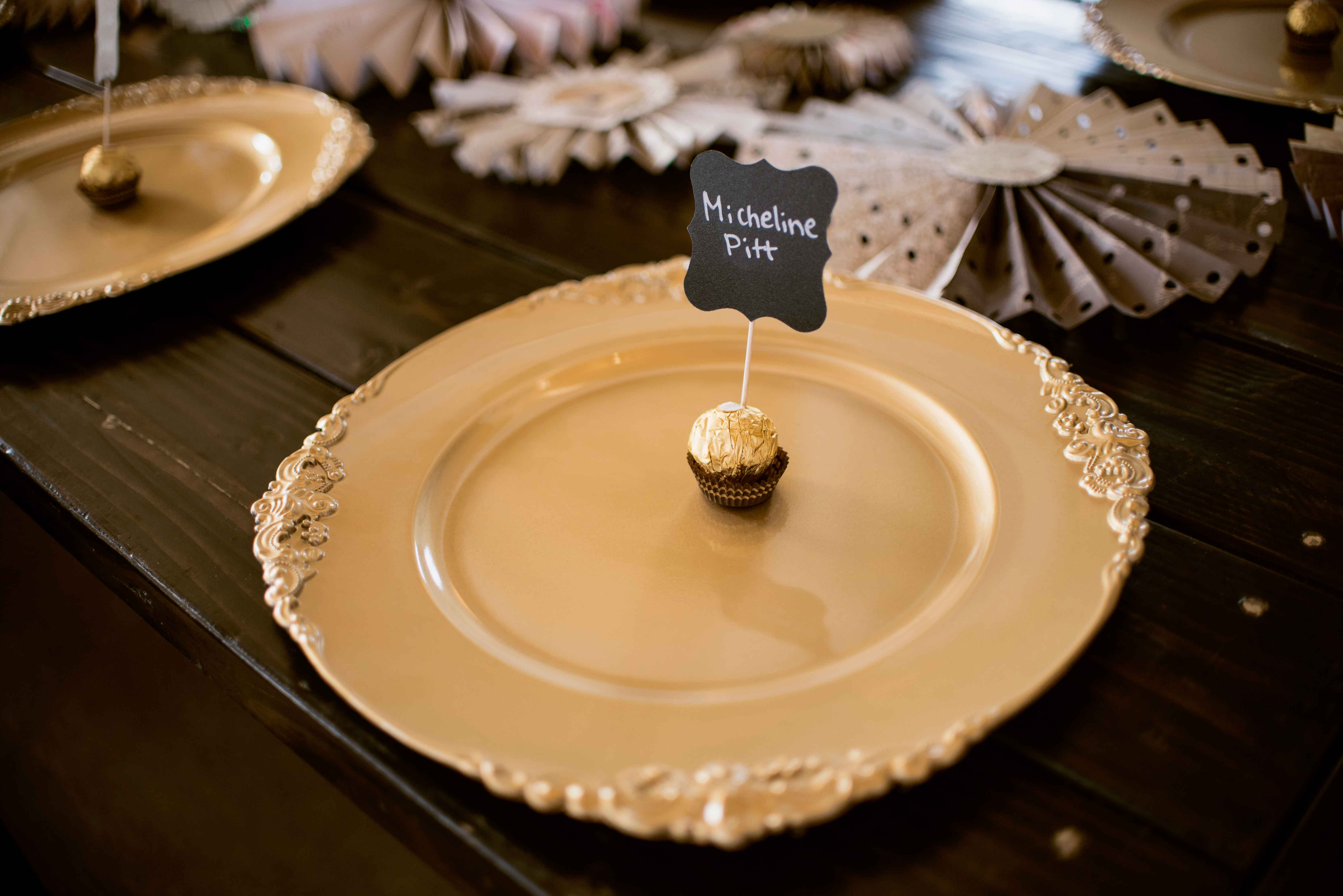Ferrero Rocher at gold place setting Miss Rockabilly Ruby wedding