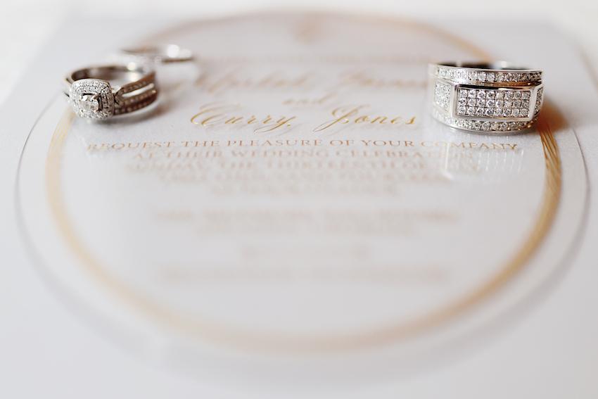 large white gold men's wedding ring with many diamonds