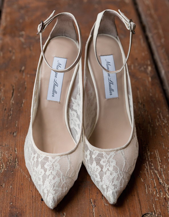 White lace Monique Lhuillier wedding shoes with ankle strap