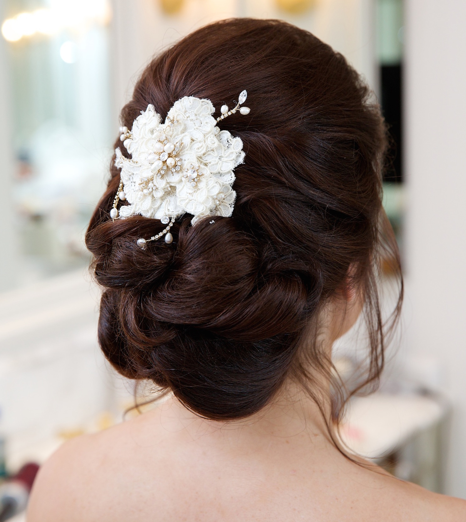 Flower hair accessory with bridal updo