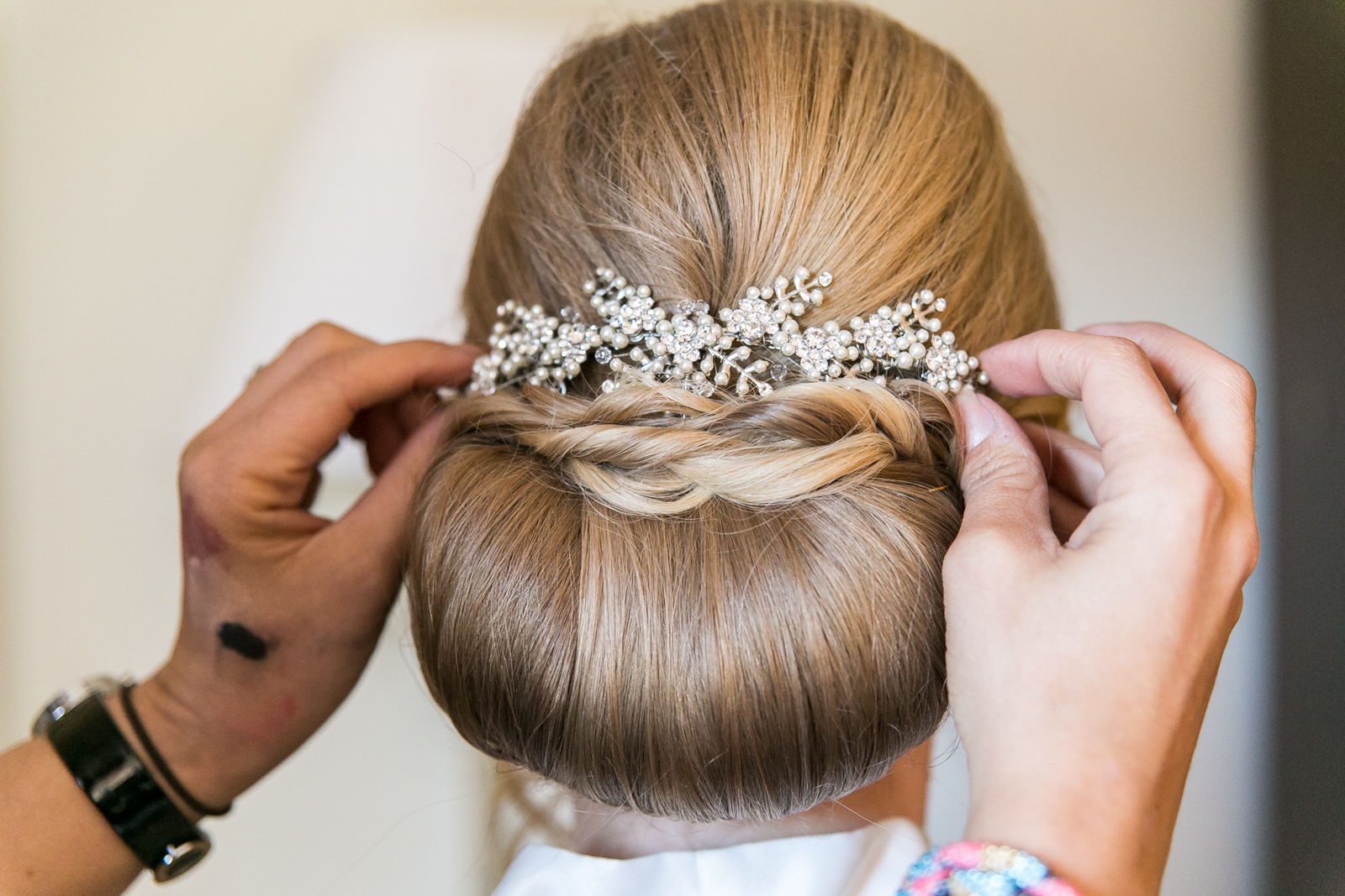 Headpiece on bride's updo above bun