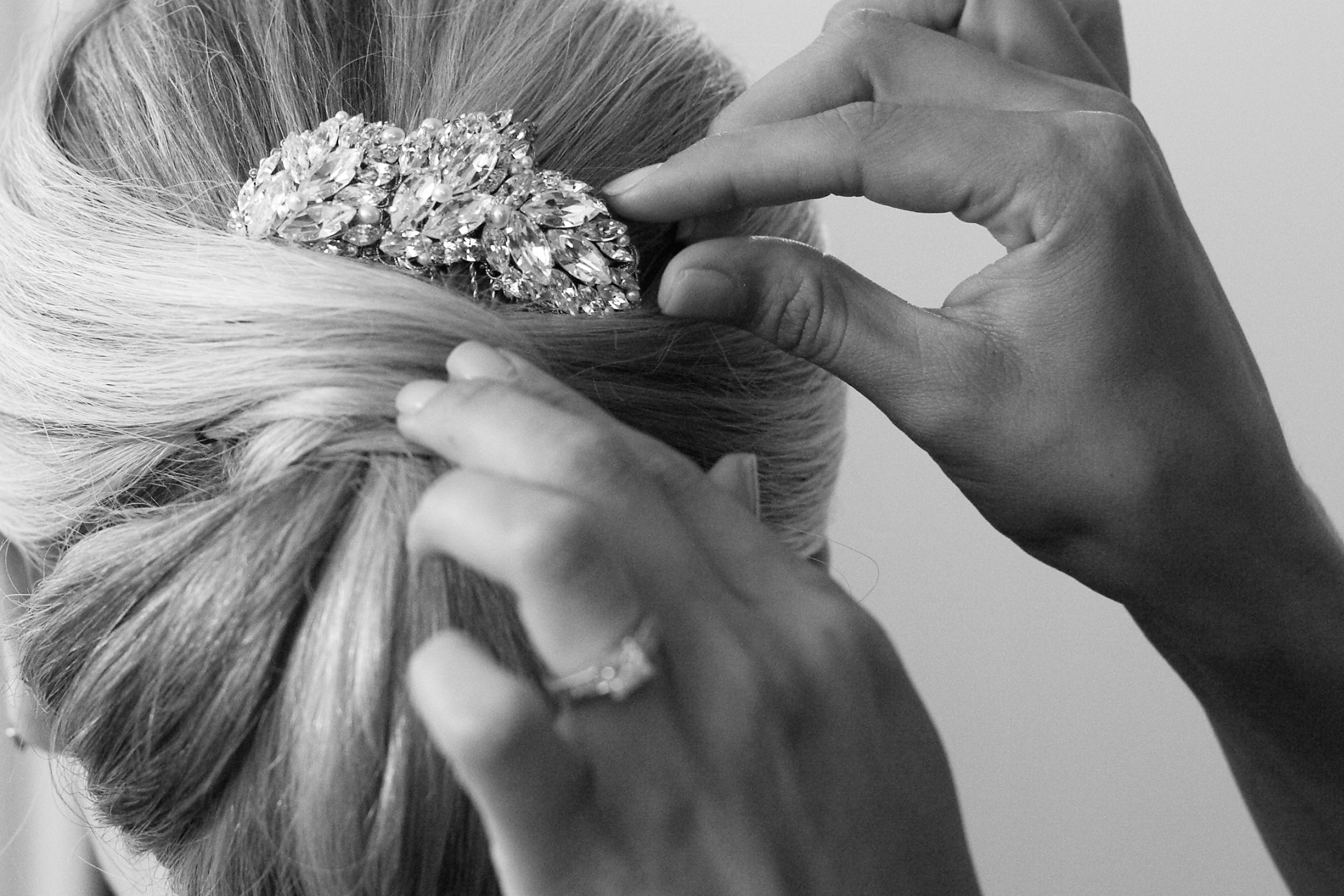Black and white photo of jewel headpiece in hair updo