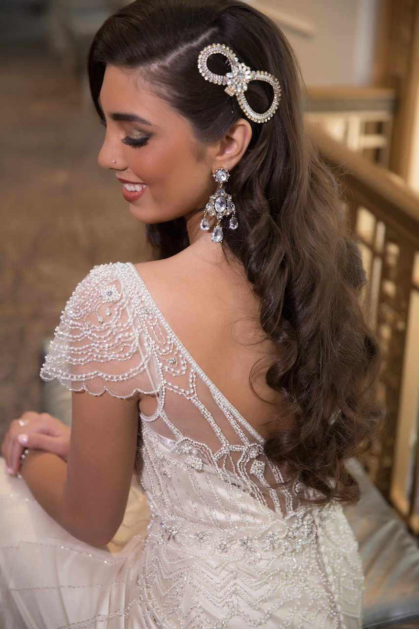 Infinity symbol in jewel on bride with long hair