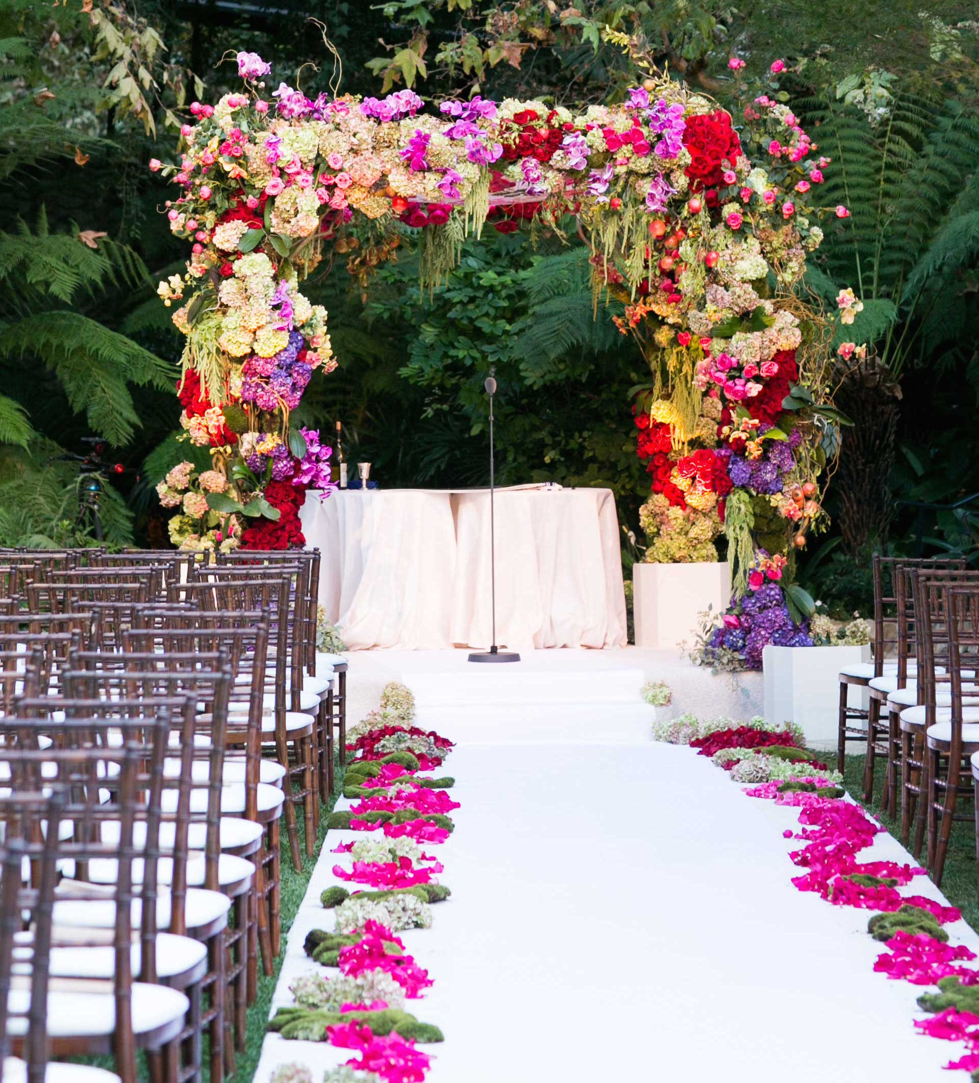 Pink purple green flower verdure outdoor wedding chuppah