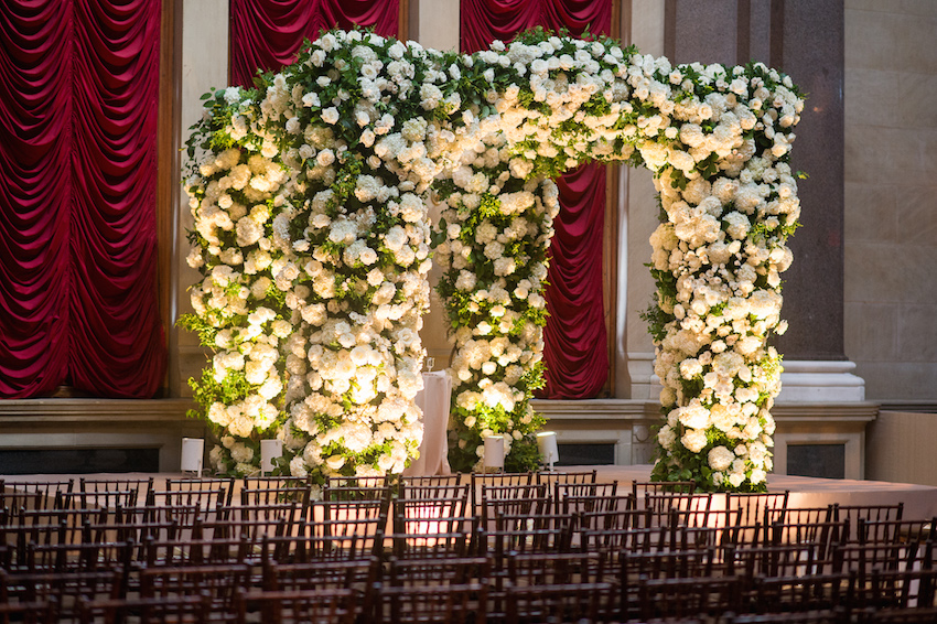 White rose flower and greenery chuppah indoor Jewish wedding