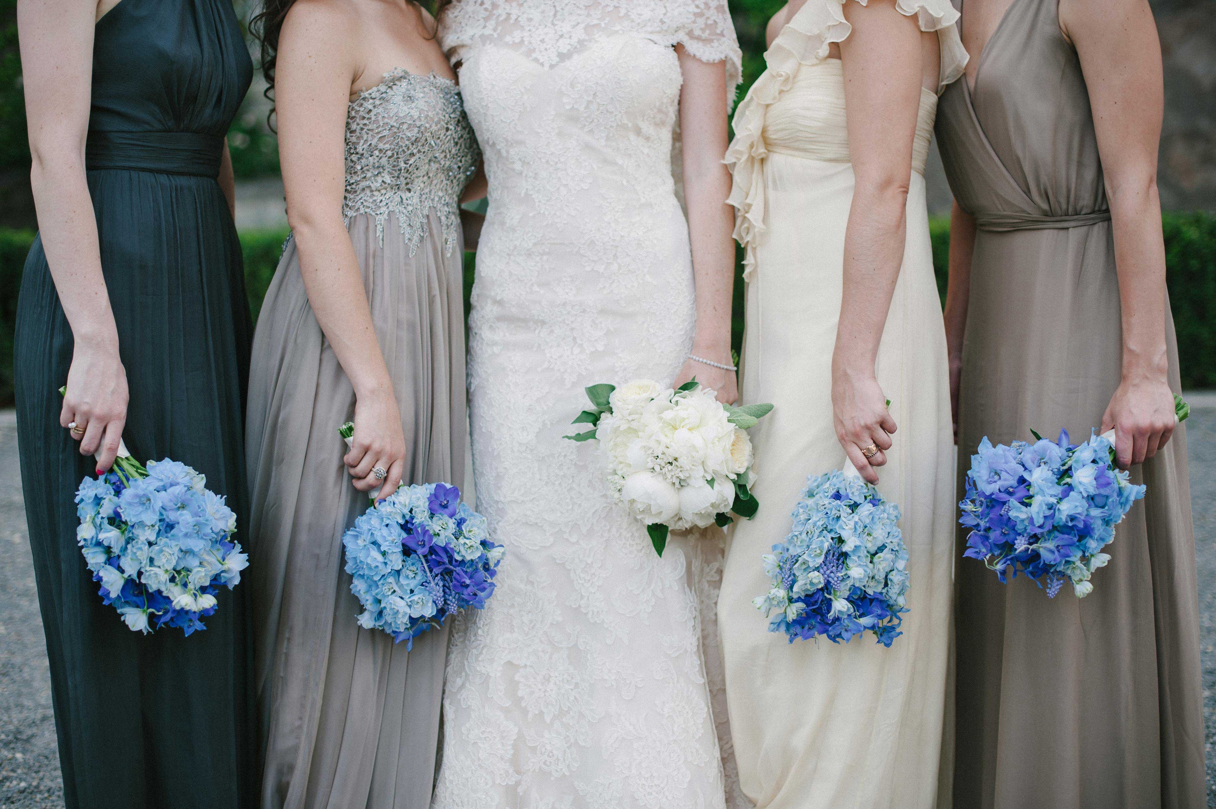 Bridesmaids with bright blue bouquets