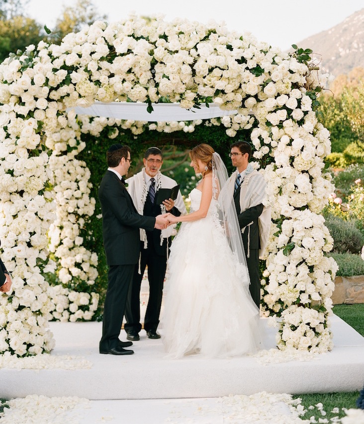 Outdoor wedding white flower chuppah Jewish ceremony