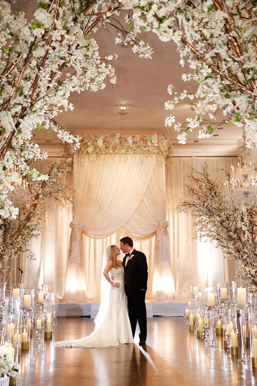 Chicago indoor wedding ceremony tall chuppah with flower canopy