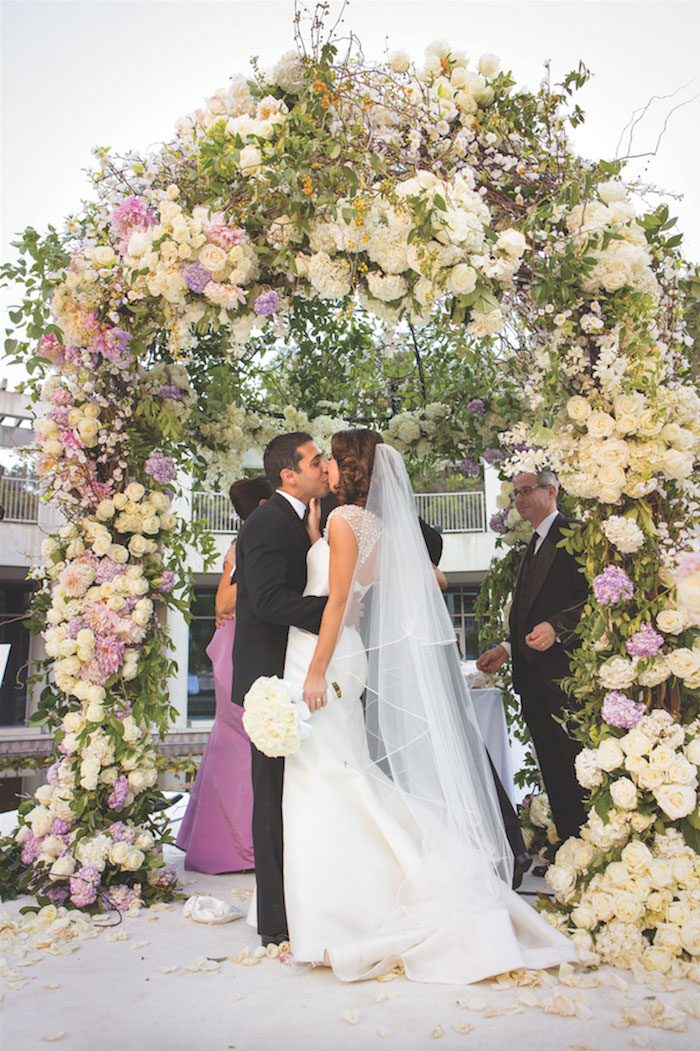 White purple pink outdoor wedding chuppah Jewish ceremony