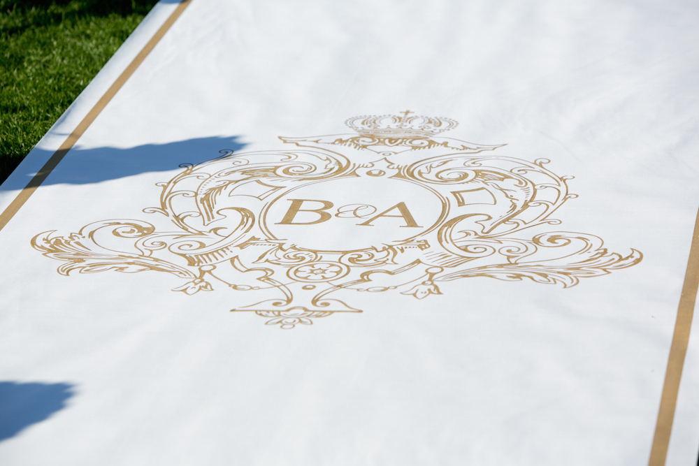 White and gold monogram aisle runner