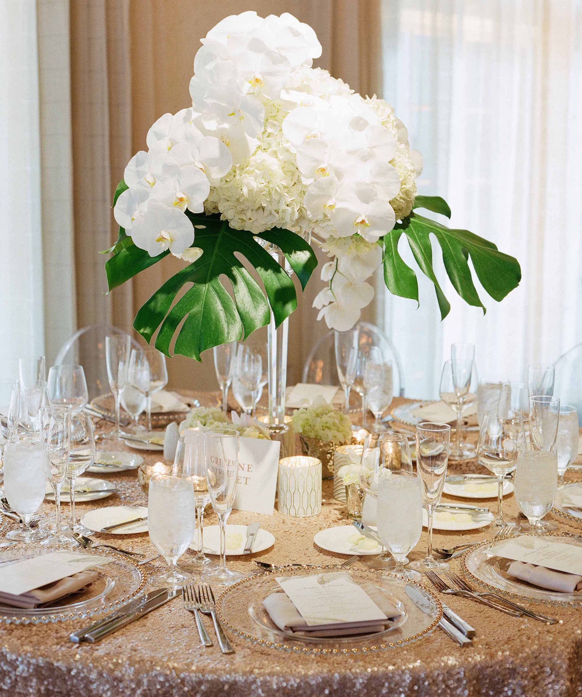 Gold sequin reception linen with white flowers and decor