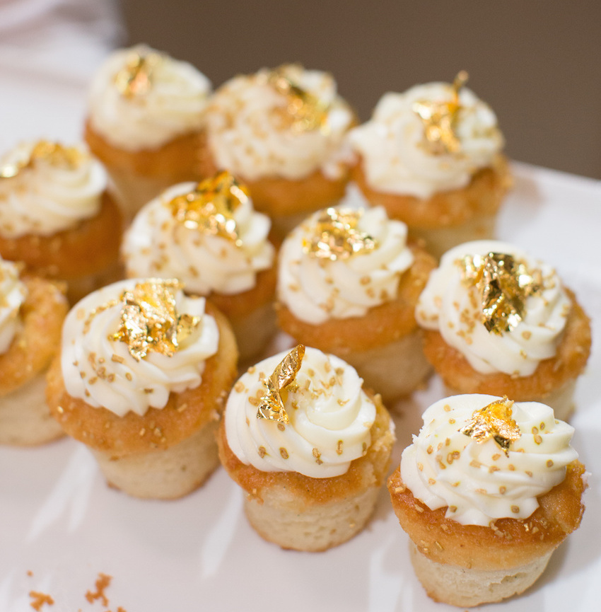 Gold leaf on wedding cupcakes at reception