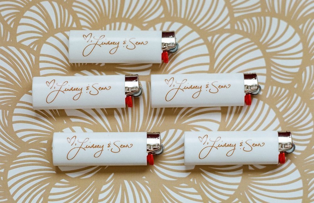 Wedding favors lighters with bride and groom's names