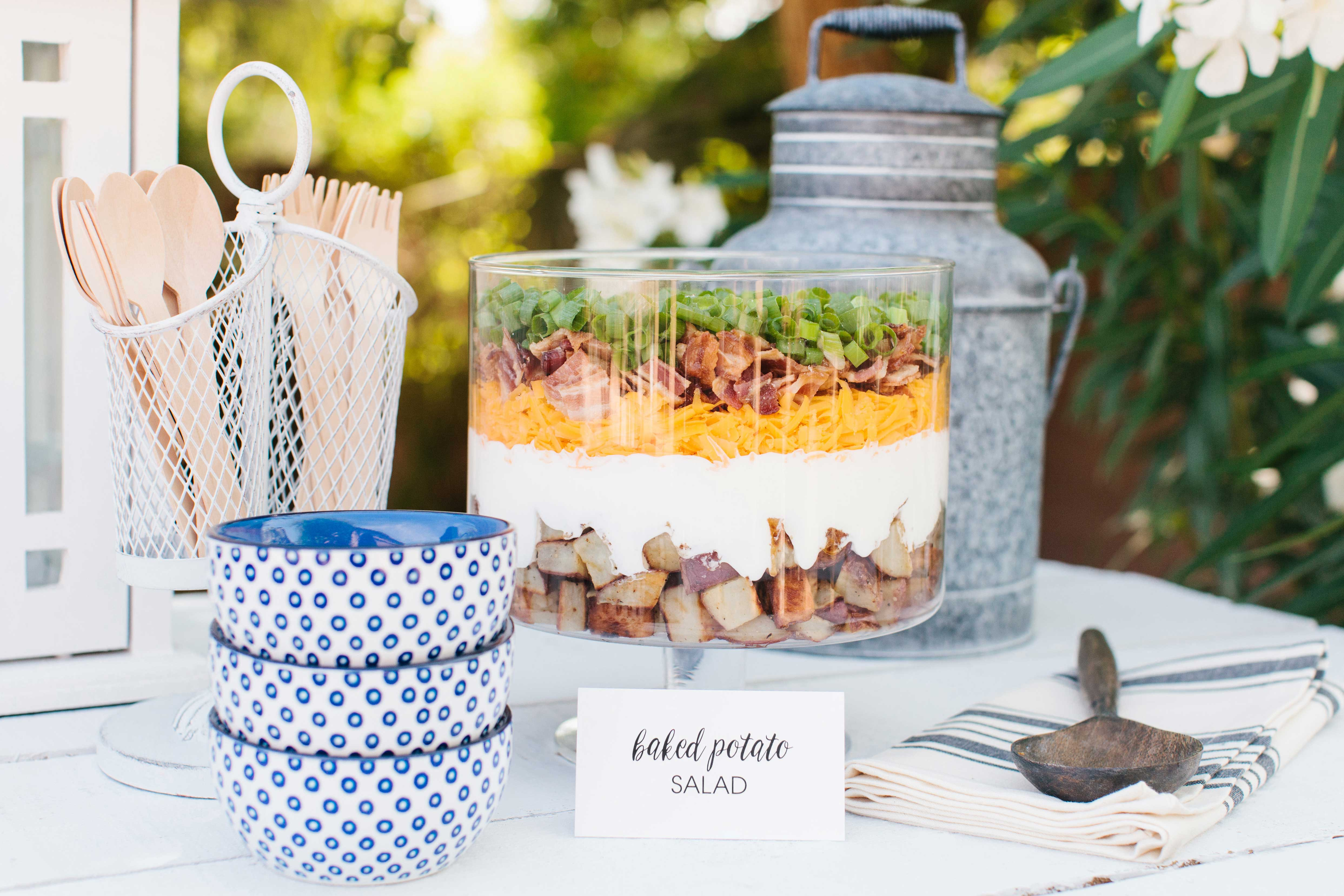 Layered potato salad display at outdoor event for summer wedding