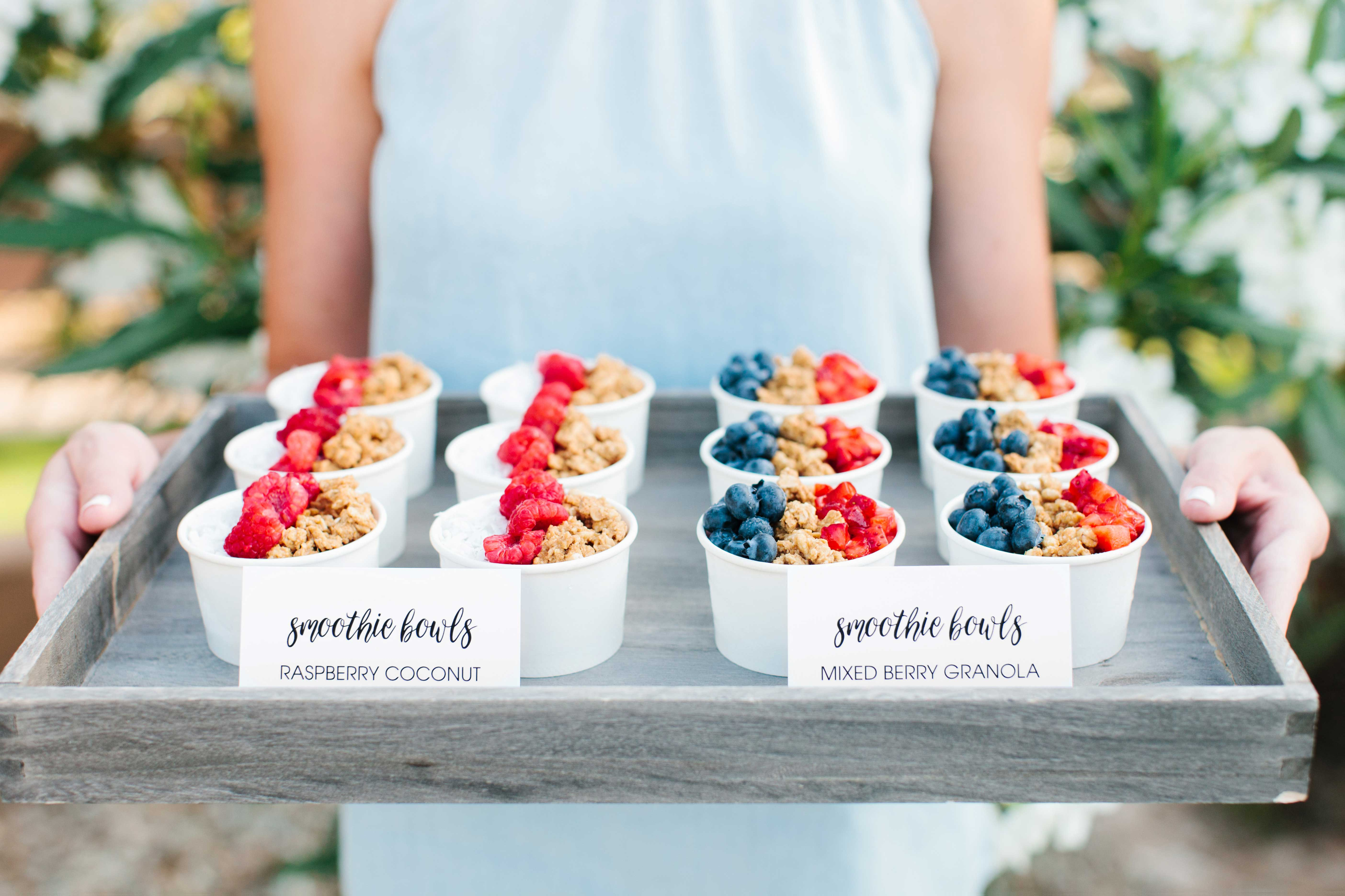 Raspberry coconut and mixed berry granola smoothie bowls on tray