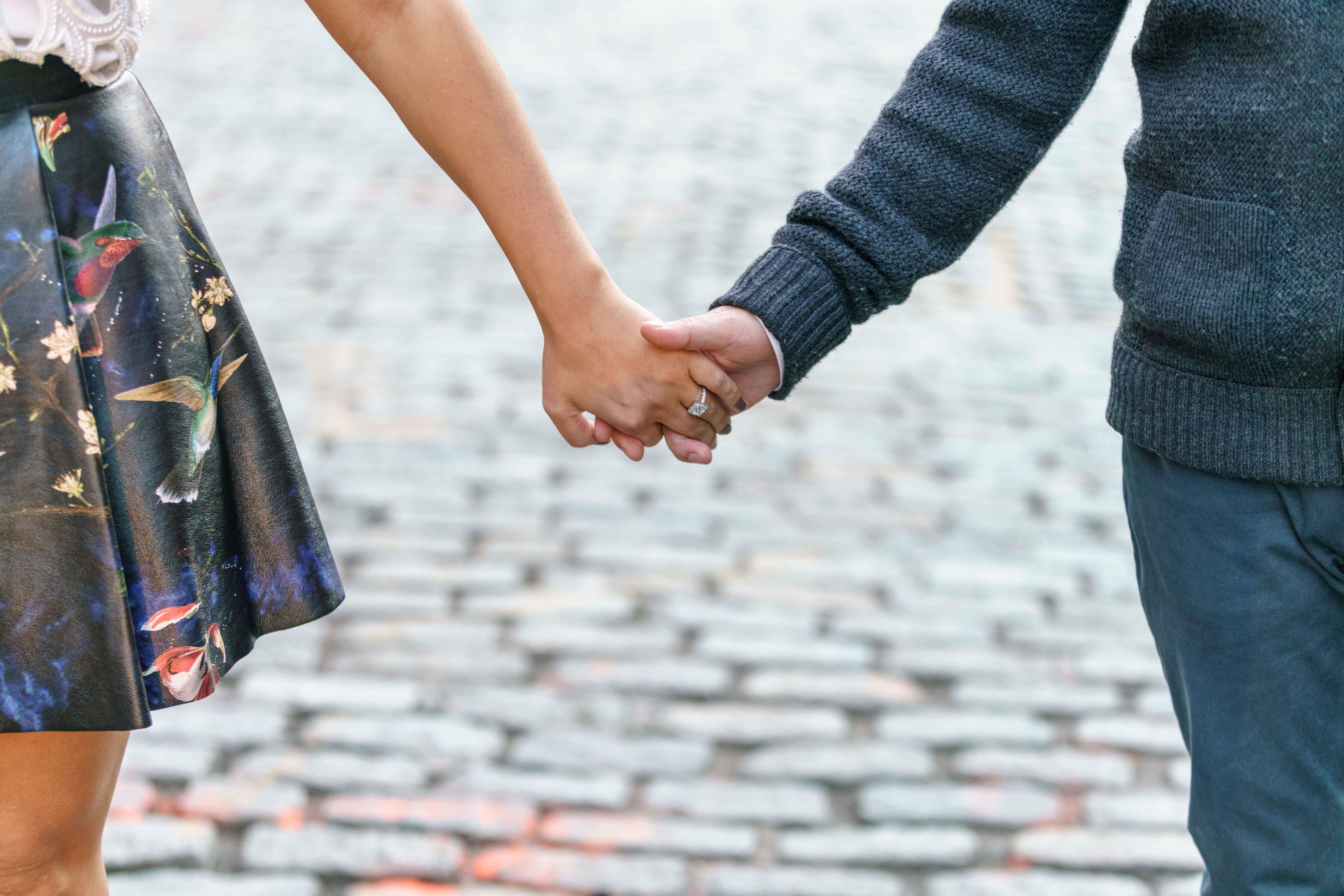 Katrina Mitzeliotis engagement photo close up holding hands engagement ring