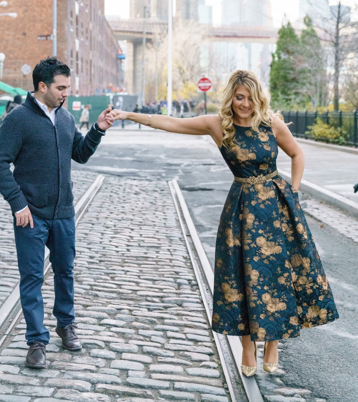 Katrina Mitzeliotis navy blue and gold dress engagement photo shoot in Tribeca New York City