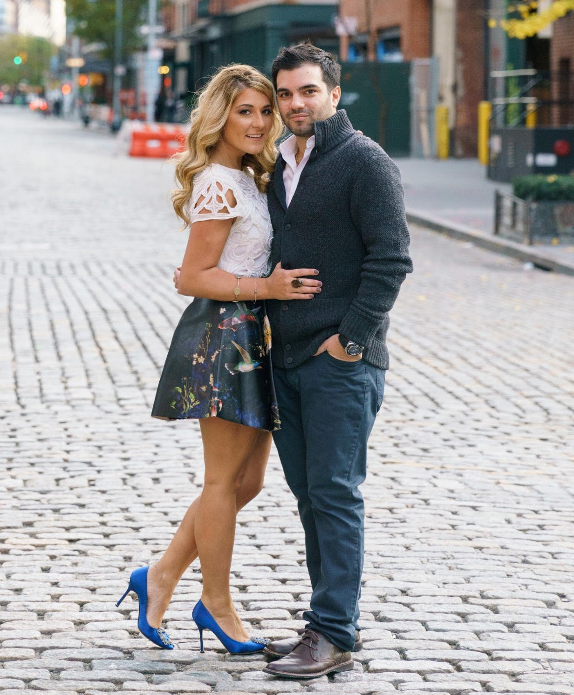 Katrina Mitzeliotis engagement photo in blue high heels on cobblestone streets New York City