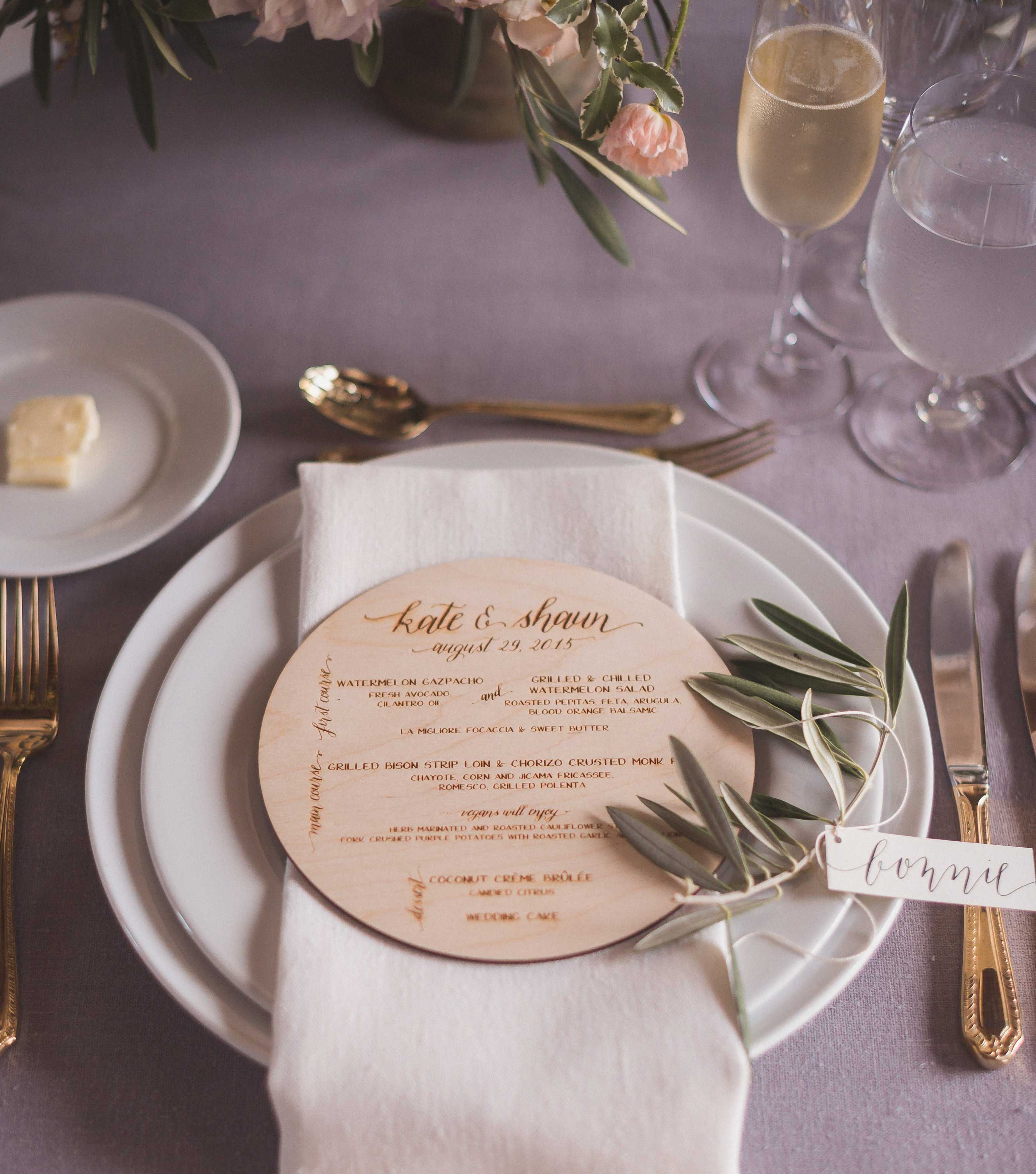 Rustic wedding menu on circle of wood slab