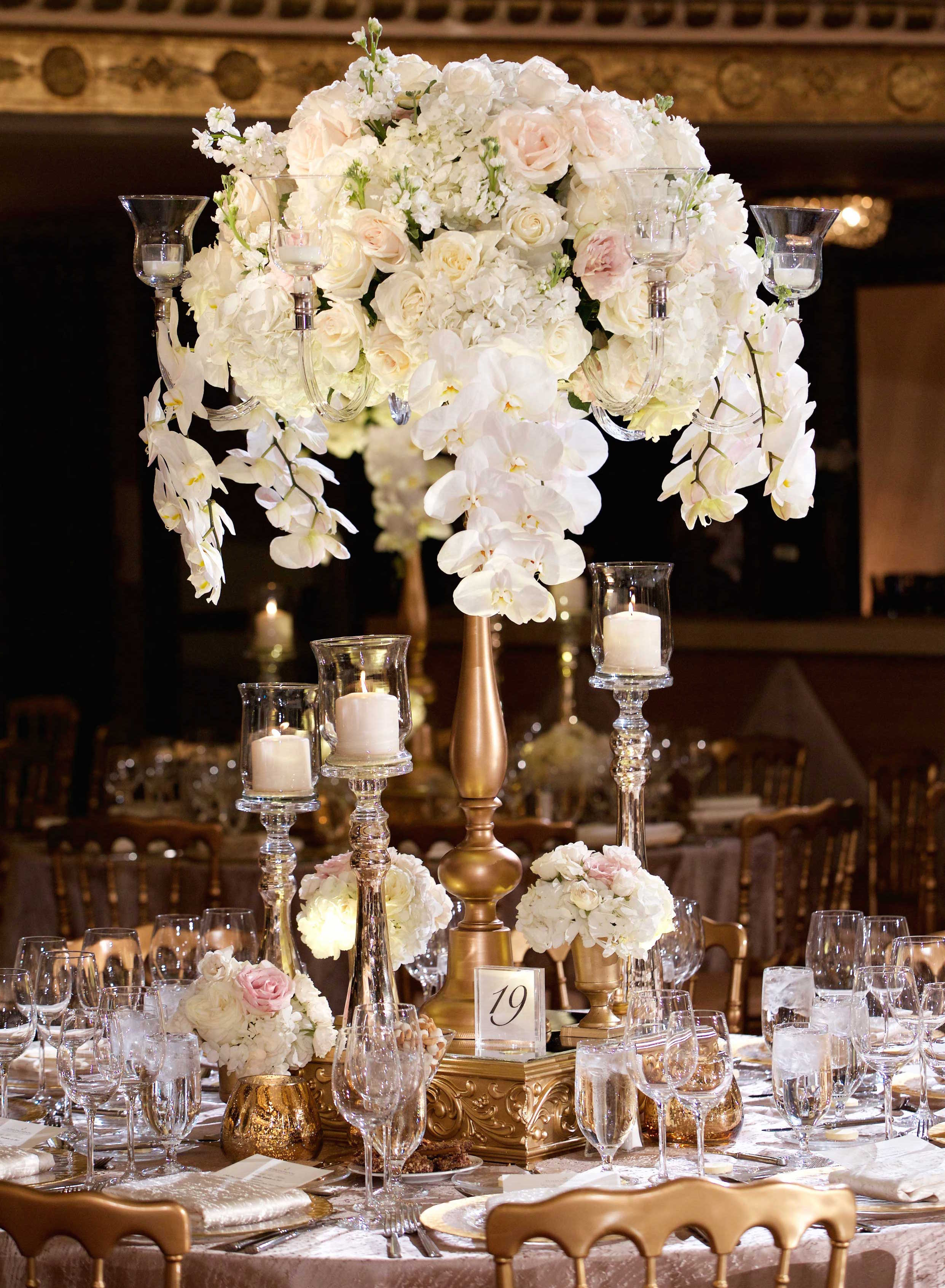 Tall wedding centerpiece white orchid blush roses on gold stand