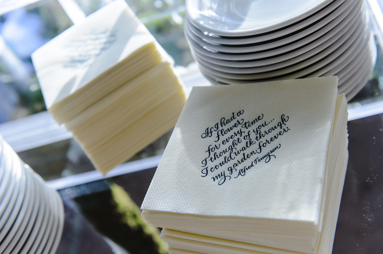 Sentimental and playful quotes to use in wedding dcor inside weddings alfred tennyson love quote on cocktail napkin at wedding reception junglespirit
