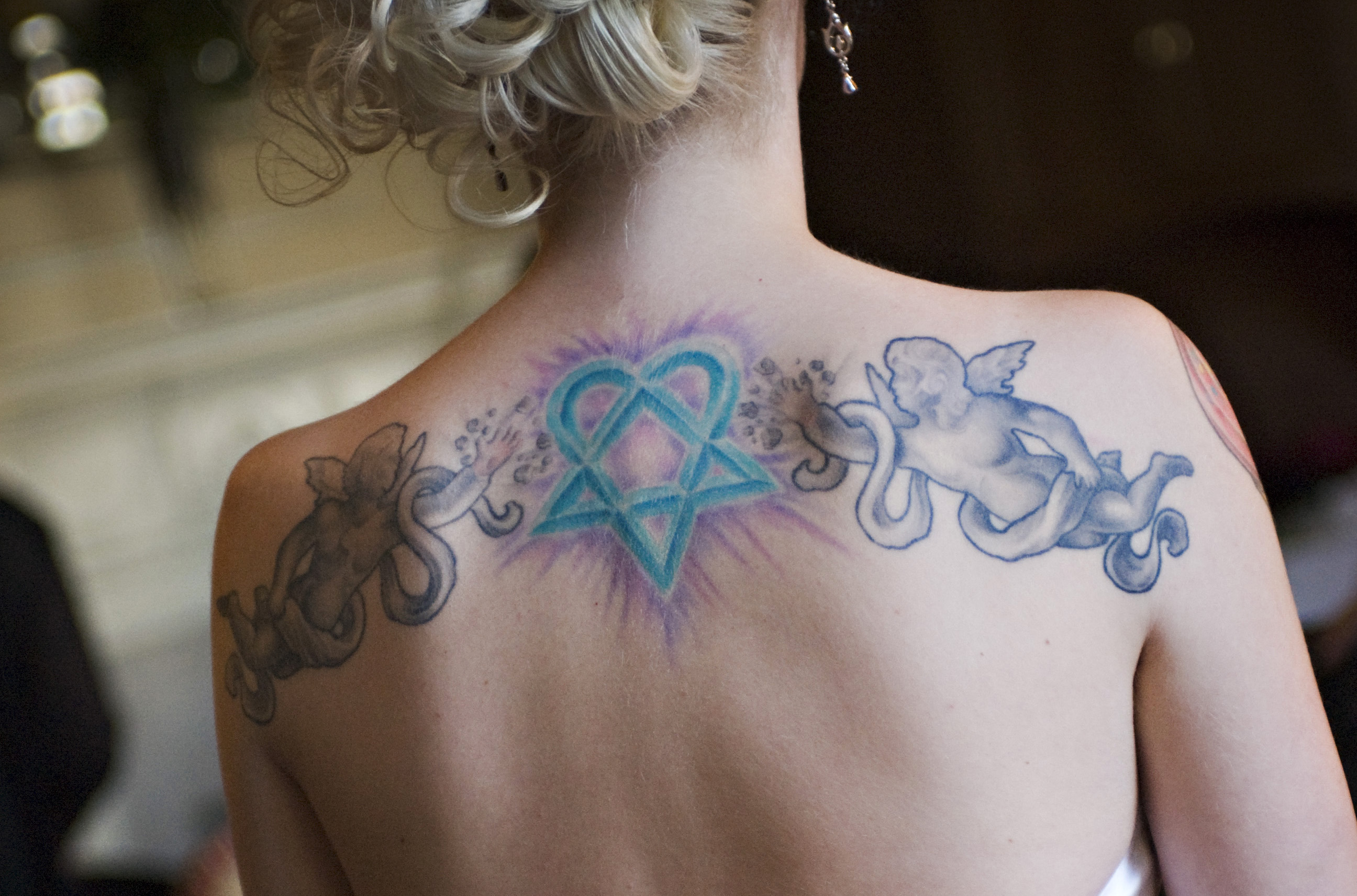 Pros And Cons Of Covering Your Tattoos And Removing Piercings For