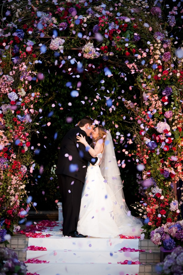 confetti thrown during first kiss as husband and wife