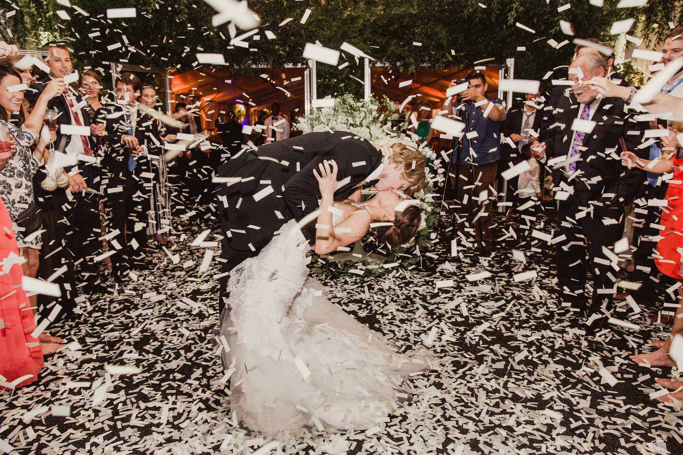 confetti cannon shoots off during newlyweds' first dance