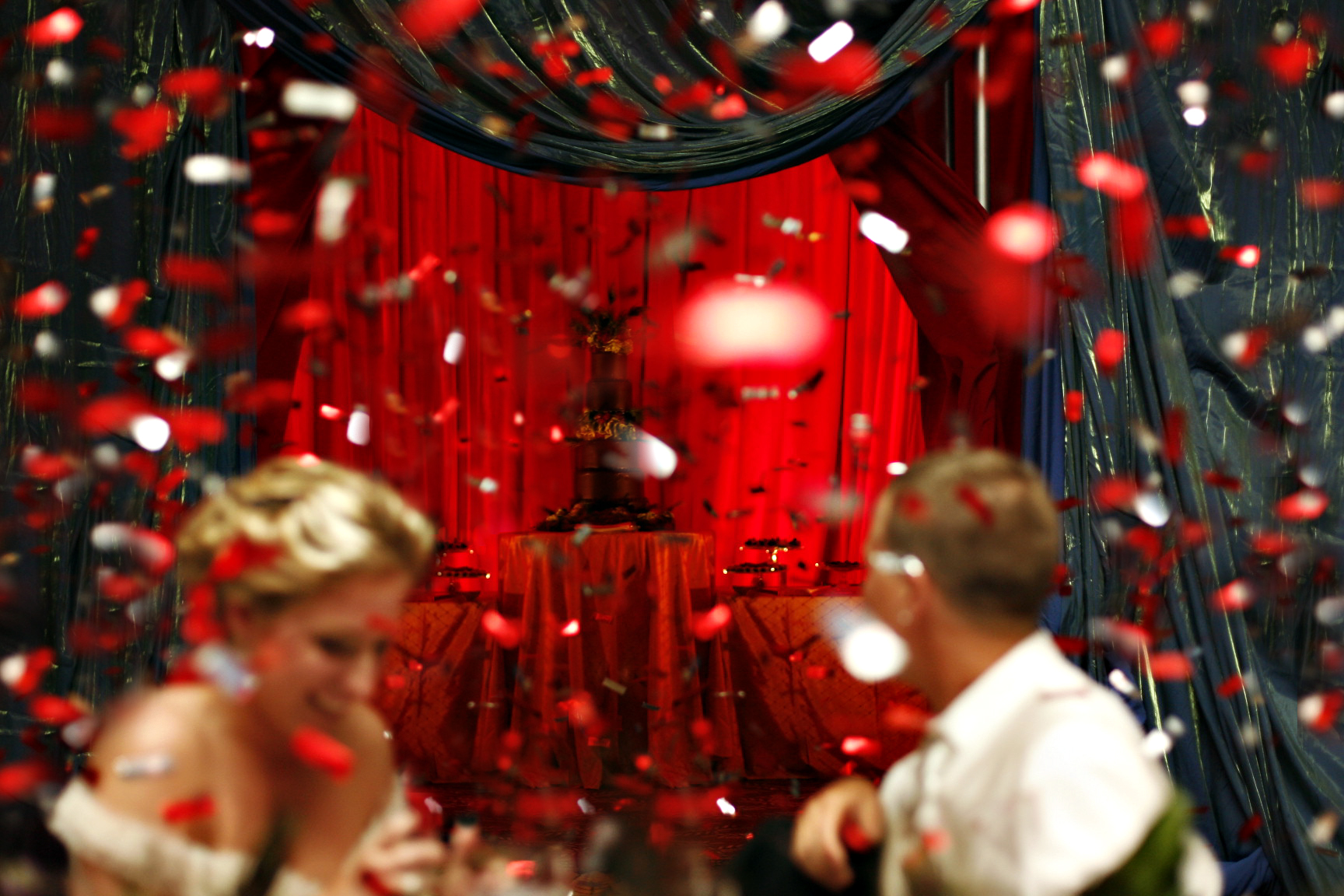 wedding with red confetti falling over dance floor