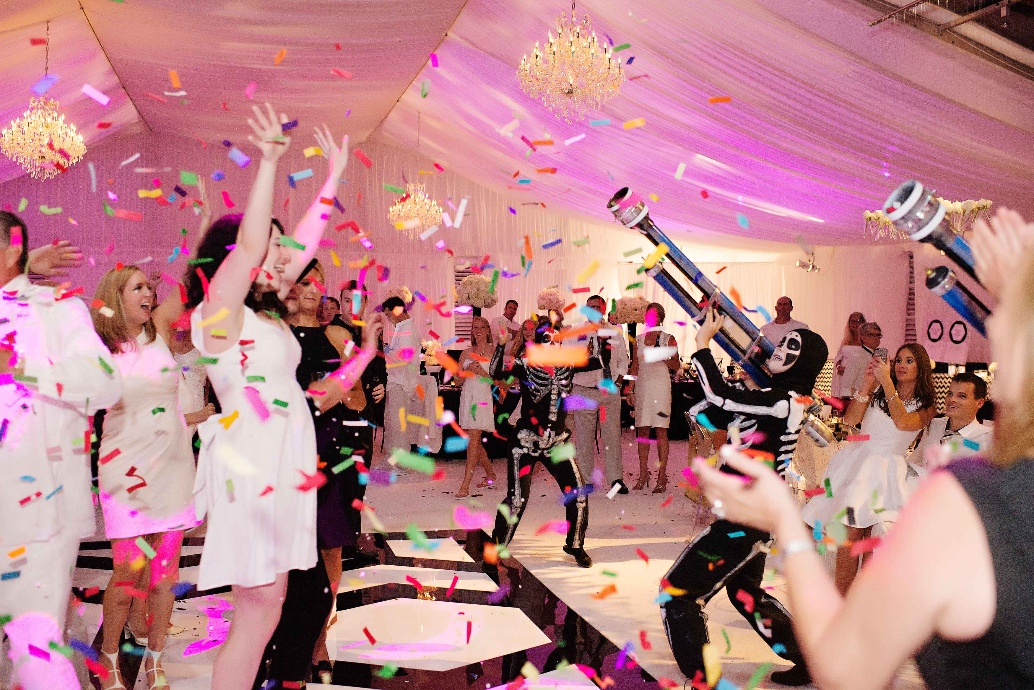 colorful confetti shot out over wedding dance floor